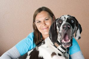 Veterinarian staff with her Great Dane