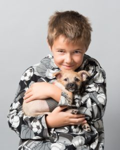 Boy with his new puppy