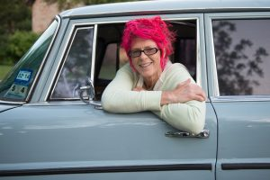 Pink haired lady in her vintagemobile